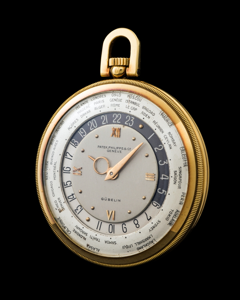 "Patek Philippe ""The yellow gold Worldtime pocketwatch retailed by Gübelin"" 0"